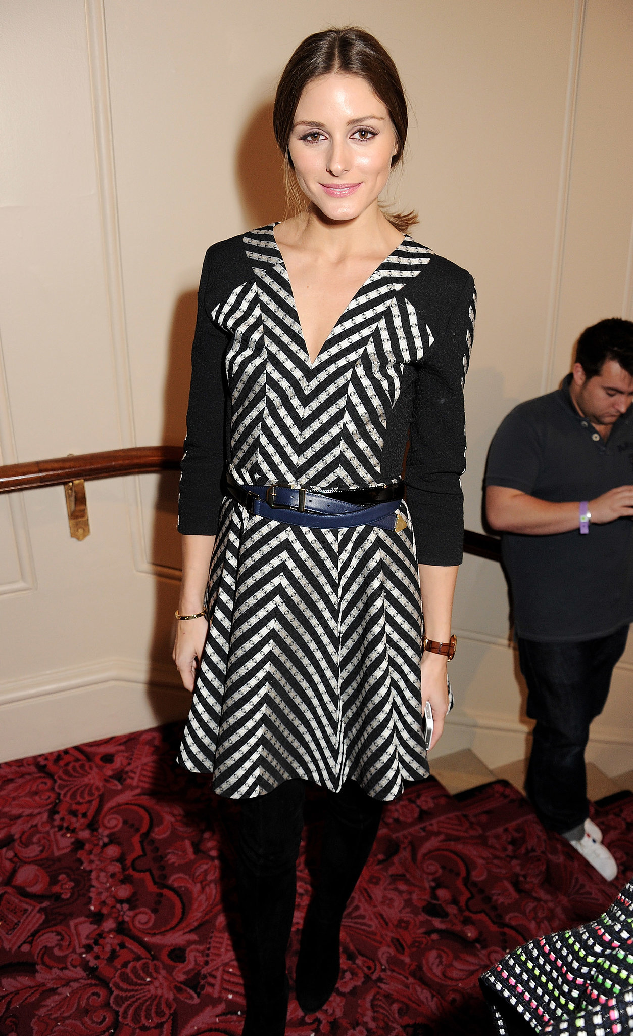 Olivia cinched her printed Matthew Williamson dress with a navy belt at the designer's show during London Fashion Week.