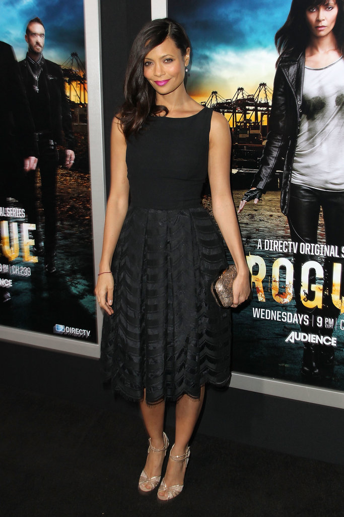 For a retro-chic feel, dress your bridesmaids in a little black fit-and-flare dress like the vintage one Thandie Newton wore to the Rogue premiere in LA. Add gold accessories and a bright lip for a pop of color.