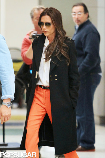 Victoria Beckham strutted her stuff in orange pants.