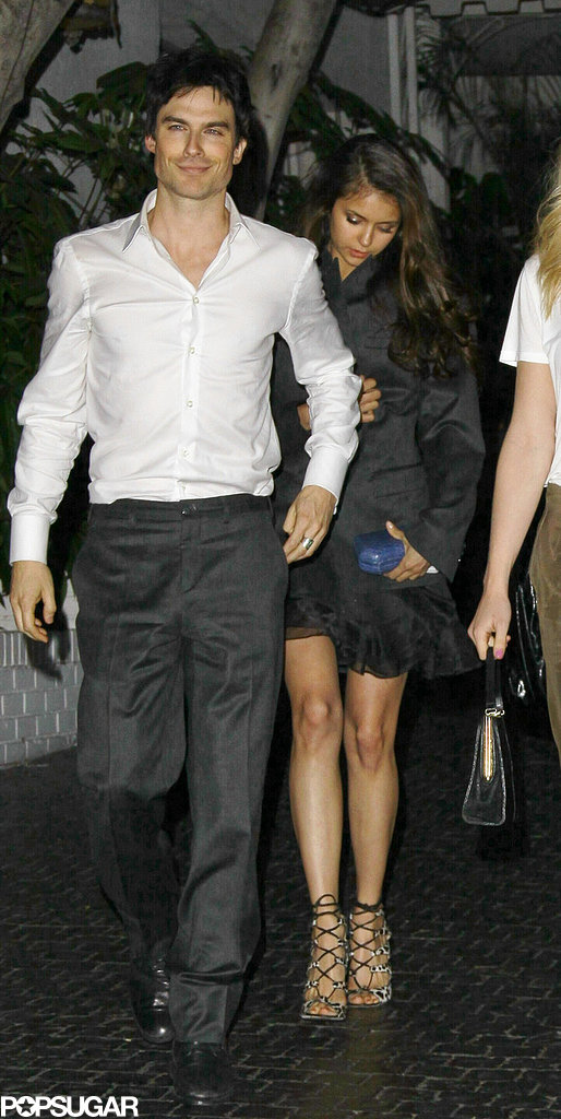 Nina Dobrev stayed close to Ian Somerhalder during a night out in March 2012.