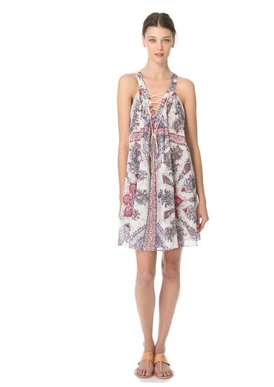 With its bohemian print and lace-up detailing, this Zimmermann Runaway V Neck Coverup dress ($395) is everything we'd want in a breezy vacation dress — or a great music festival look.