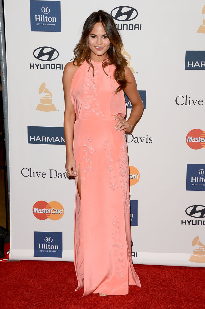 Chrissy Teigen's peachy halter gown has a flowy, ethereal feel that would meld beautifully at a wedding by the water. Add beachy, wavy hair like the model's to match.