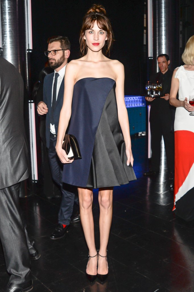 Alexa Chung attended a dinner party in NYC wearing a strapless navy-and-black A-line minidress.