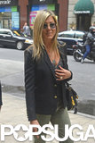 Jennifer Aniston Stops to Shop With That Famous Hair