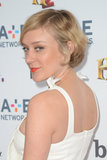 Chloë Sevigny wore a Summer-perfect look: short hair with flirty lashes and bright orange lips.