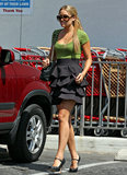 LC downplayed her full ruffled skirt with a green tee and black Mary Jane pumps while out and about in Hollywood in 2008. Lesson from Lauren: counterbalance a full skirt with a simple formfitting top.