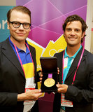The prince, seen here with a gold medal in London, deserves an award for his handsome looks.