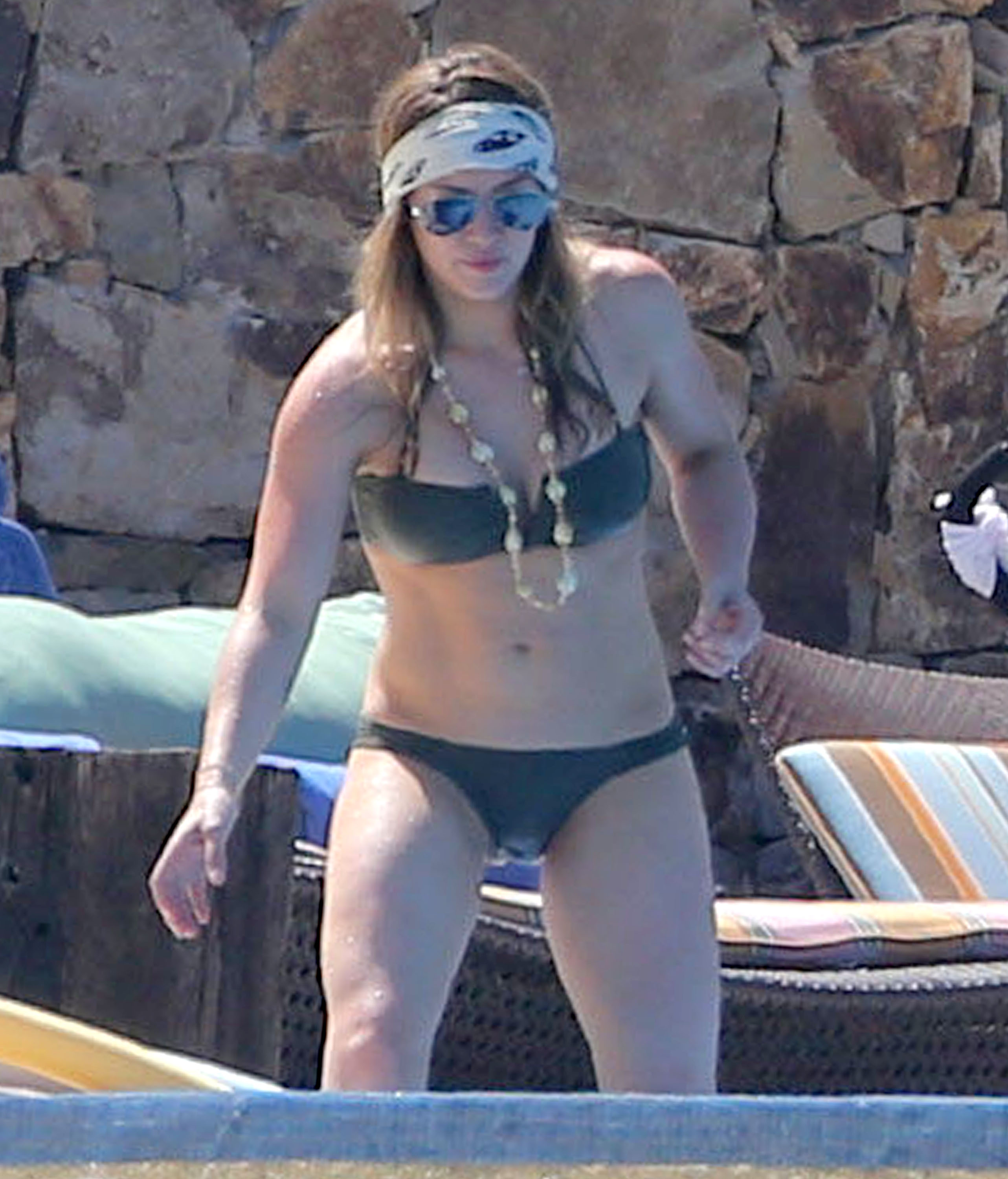 Hilary Duff channeled her inner Axl Rose in a skull head scarf and aviator sunglasses during a getaway to Cabo San Lucas in May 2013.