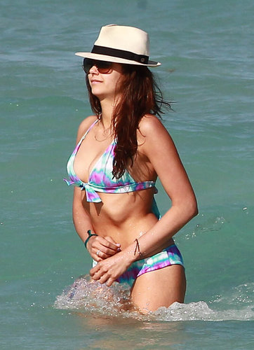 Nina Dobrev swam in a printed bikini and a fedora in Miami.