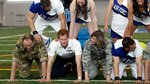 Video: Why Is Prince Harry in a Human Pyramid? Find Out!