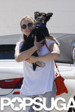 Kristen Bell smiled while holding her dog.