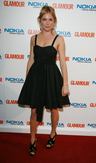In 2007, Sienna Miller matched black sandals to a summery black fit-and-flare dress at the Glamour Women of the Year Awards.