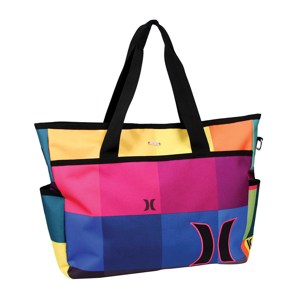This bright and fun Hurley Sync Beach Tote ($40) has a home for your wallet, sunglasses, umbrella, sunscreen, and two side pockets for bottles of water or cups.