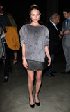 Kate Bosworth looked part cozy, part glitzy in a textured gray topper, sequined miniskirt, and black pumps at the Topshop Unique fashion show during Fall/Winter 2013/2014 London Fashion Week.