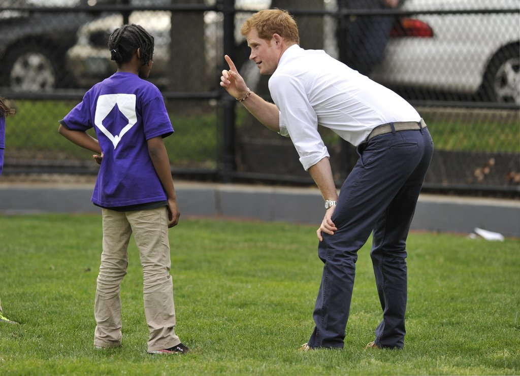 Prince Harry chatted with a young girl while visiting a youth program in Harlem on Tuesday.