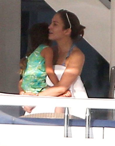 Jennifer Lopez held on to her daughter Emme while relaxing on a yacht in Miami in January 2013.