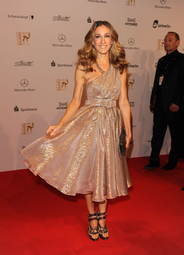 The blond beauty shimmered in a golden one-shoulder Halston, strappy bronze sandals, and glistening clutch at the 2010 Bambi Awards.
