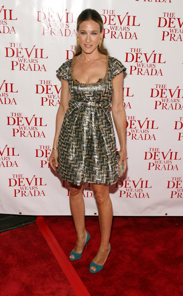 For the Fox premiere of The Devil Wears Prada, Parker radiated in a brocade mixed-metal mini and teal peep-toe platforms. Dripping gold earrings and a poufed ponytail rounded up her late-night look.