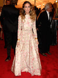 For the 2012 Met Gala, Sarah Jessica Parker chose a long-sleeved floral Valentino gown complete with matching pointy-toe pumps. Her gold cuffs on both wrists and silver drop earrings lent a touch of edge.