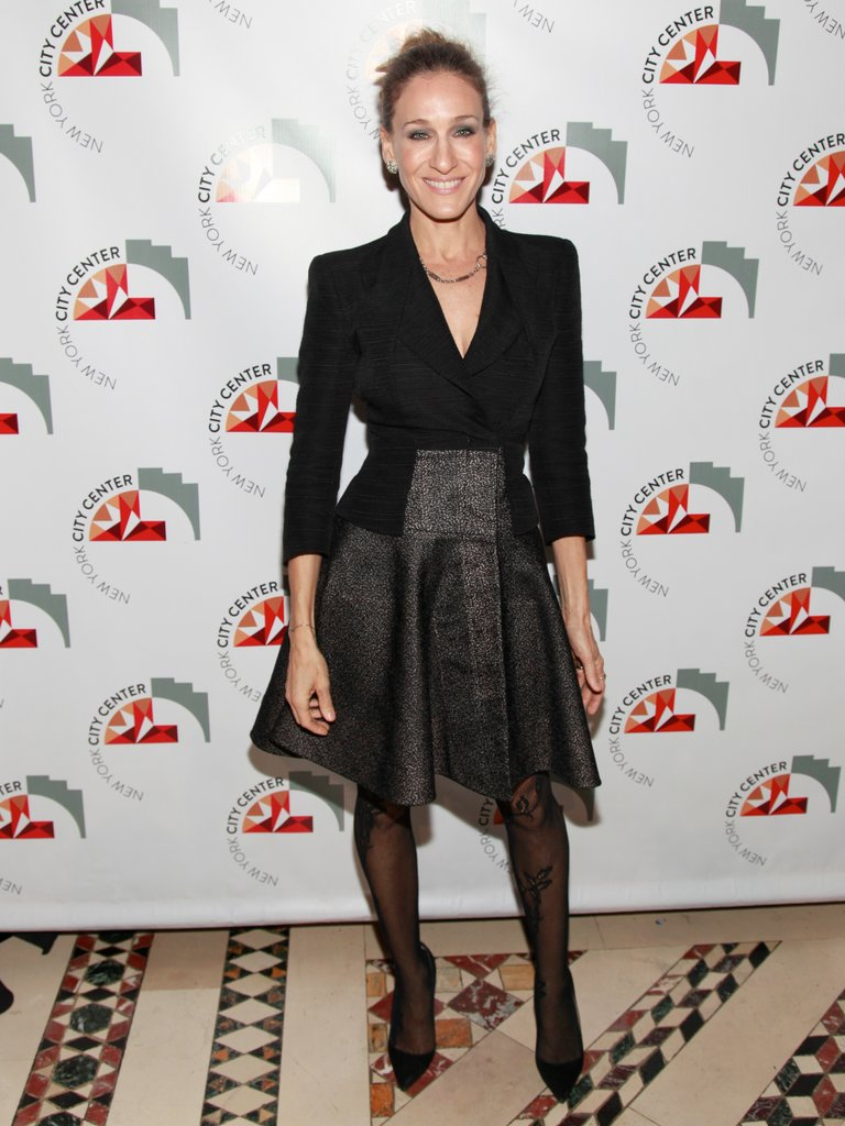 SJP jazzed up her structured Antonio Berardi ensemble with patterned tights and a messy top-knot bun at the NYC Center Reopening Gala in October 2011.