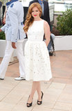 Isla Fisher posed in a white dress at a photocall for The Great Gatsby.