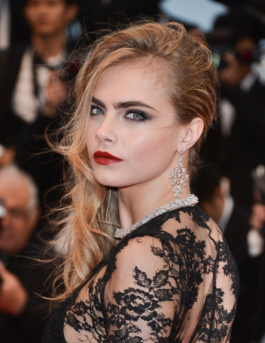 Cara Delevingne's hair had a tousled texture due to the wet weather on the Great Gatsby red carpet, but her dark smoky eye and oxblood lip withstood the wind and rain well.
