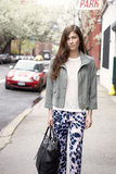 Boldly printed pants make this outfit. Keep the rest simple, with a loose knit and faded khaki jacket.