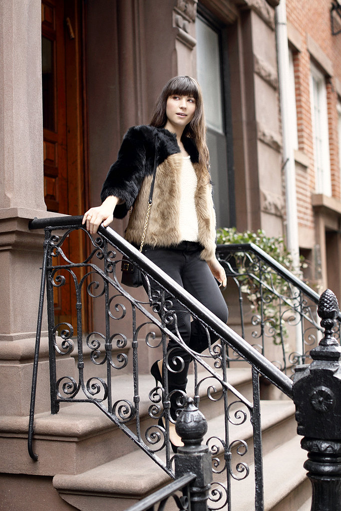 A fur coat goes mod in colorblocked black and brown.