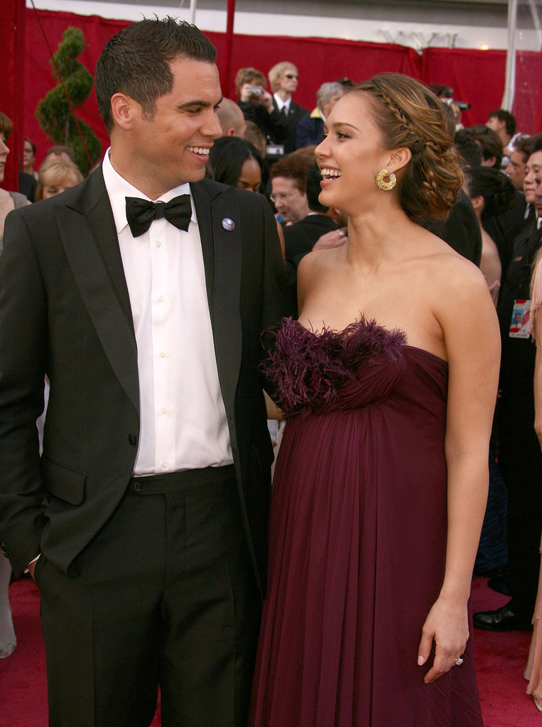 Cash Warren and Jessica Alba have a loving red-carpet moment in LA at the 2008 Oscars.