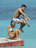 Jessica Alba watched as Cash Warren cannonballed into the St. Bart water while on vacation in April 2013.