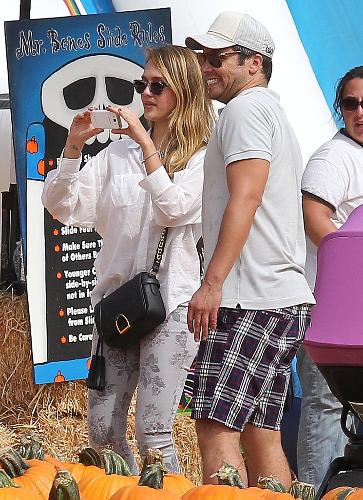 Jessica Alba and Cash Warren snapped pictures of their kids at an LA pumpkin patch in October 2012.