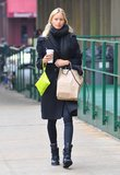 Queen of the off-duty look, Karolina Kurkova teamed wedge sneakers with leggings and a classic knee length black coat.