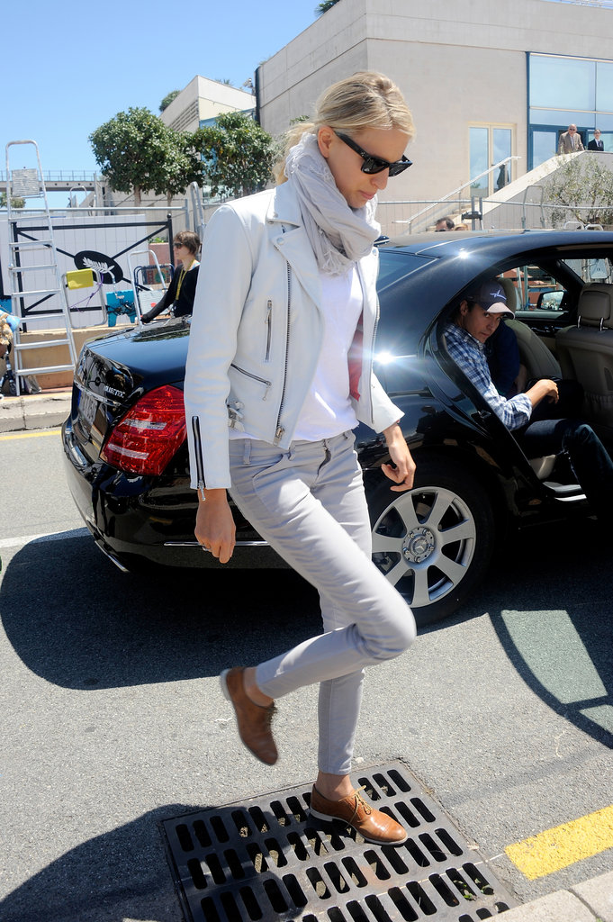 Karolina Kurkova popped up in Cannes looking cool as ever in a white leather biker jacket, grey skinny jeans, and tan oxfords.