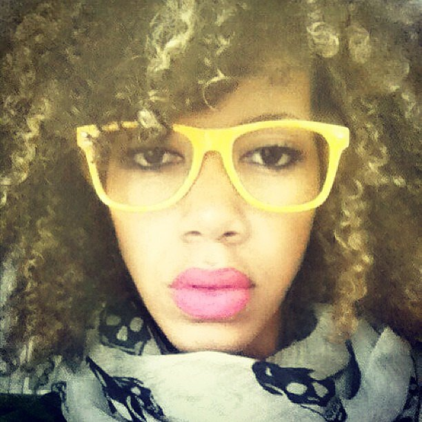 Bold lips and highlighted curls go well with bright yellow frames. Source: Instagram user hannahjobe