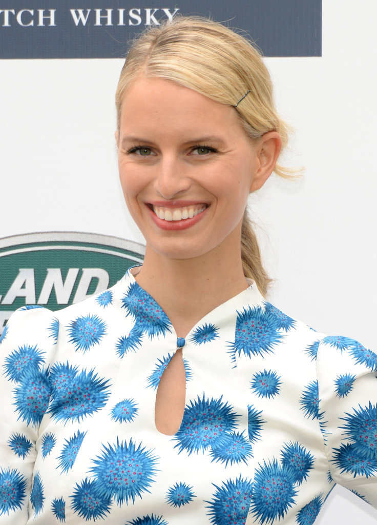 Karolina Kurkova was at the Sentebale Royal Salute Polo Cup in Connecticut during Prince Harry's visit to the US. She wore her hair in a simple low ponytail with a bobby-pin accent.