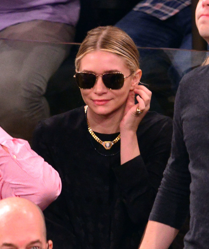 Leave it to Ashley Olsen to look ultrachic at the same New York Knicks playoff game. She sported her signature all-black, then added a gold necklace, pinkie ring, and aviator sunglasses.
