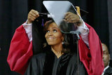 Michelle smiled as the doctoral hood was placed over her head.