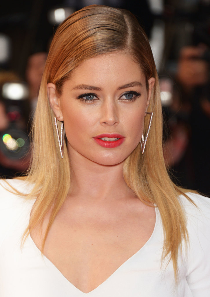 Copy Doutzen Kroes's tomato-red lip color if you're looking to break out of the traditional mold.