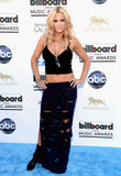 Jenny McCarthy went the midriff baring route, pairing a cropped tank top with a semi-sheer racer-band maxi skirt to complete the effect.