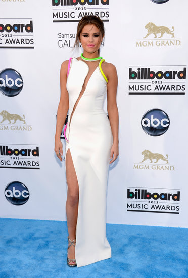 At the 2013 Billboard Awards, Selena Gomez channeled her inner sexy siren in an Atelier Versace white gown with neon accents and a thigh-high slit.