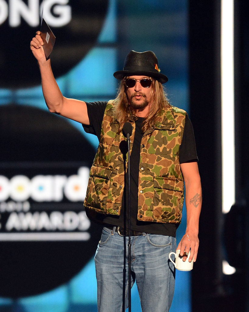 Kid Rock presented an award onstage.