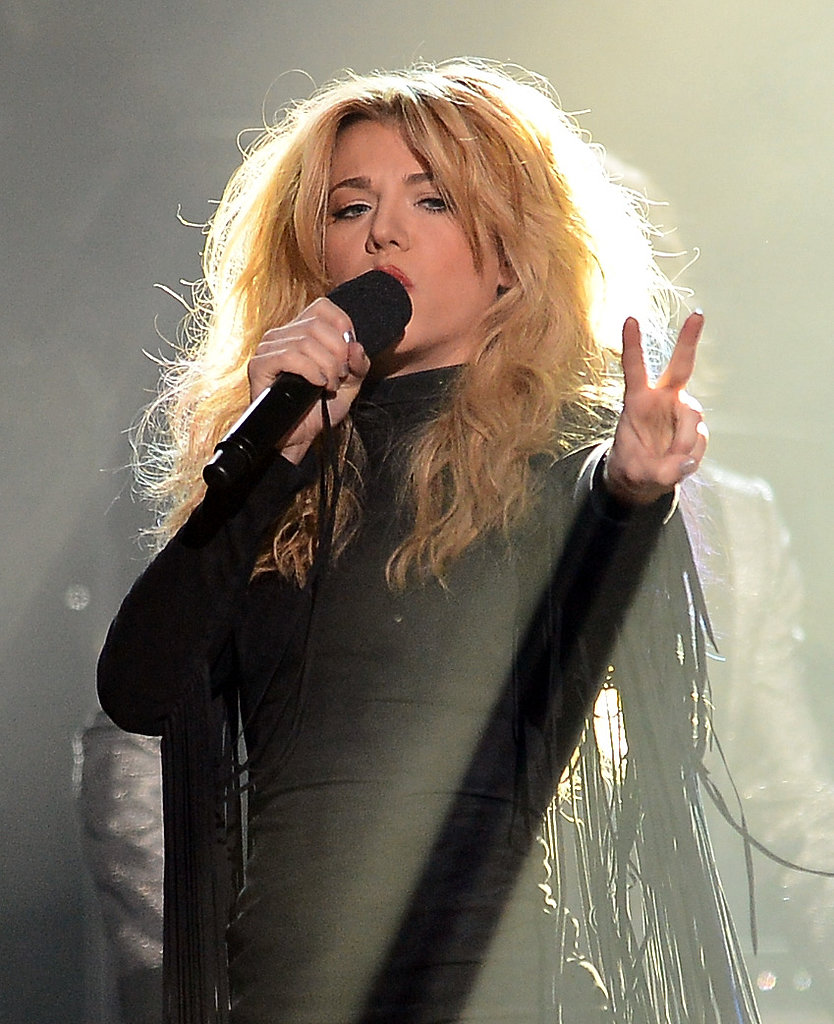 Kimberly Perry of The Band Perry flashed a peace sign during the group's performance.