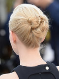 The back of Carey's head displayed a cluster of knots, forming into a twisted, structured bun.