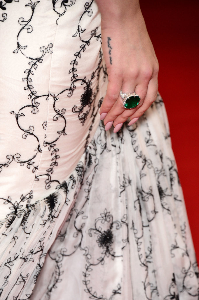 Lana Del Rey wore a large emerald ring by Chopard.