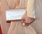 Solange Knowles carried a metallic Jimmy Choo clutch.