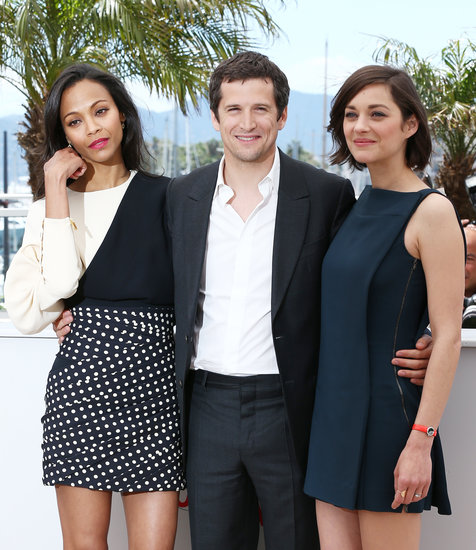 Marion Cotillard and her partner, Guillaume Canet, linked up with Zoe Saldana for the photocall for Blood Ties in Cannes.