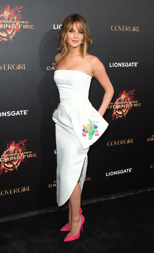Jennifer Lawrence in Dior at a party for her film The Hunger Games: Catching Fire in Cannes.