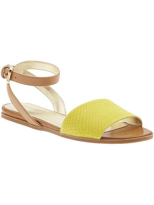 Another ankle strap! These yellow reptile-print sandals won't break the bank and keep your look both chic and fun at the same time.  See more Style Shortcuts