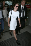 The little white dress isn't just a Summer-party staple. It travels well too, as evidenced by Emma Watson in A.L.C. And opt for easy-to-remove ankle boots for a look that says style-savvy traveler, not TSA amateur.