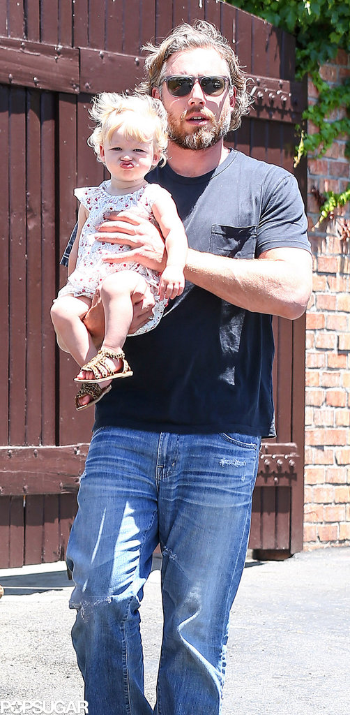 Eric Johnson toted his daughter Maxwell, who sported her usual pout.
